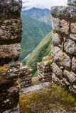 View from an Inca stone ruins town. Vertical. Ancient stone ruins of an Inca town on the Inca Trail in the Andes mountains. Cusco. Peru. South America. No stock photography