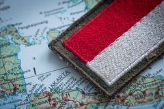 View of the Indonesian flag on the background of the map. View of the Indonesian flag on the background of the Indonesia map stock image