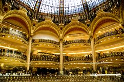 Gallerie Lafayette interior. A view of the indoor balconies and the glass dome of Gallerie Lafayette, Paris, France Royalty Free Stock Image