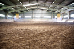 View an indoor riding arena backlight for dressage horses Royalty Free Stock Photography