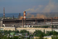 View of the industrial area of the factory `Red October` with cloud of red smoke in Volgograd Royalty Free Stock Photo