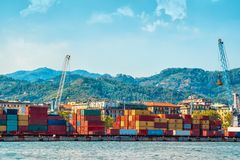 View of the industrial port in La Spezia town, Italy. Many colorful cargo containers for transportation. View of the industrial port in La Spezia town, Liguria royalty free stock images