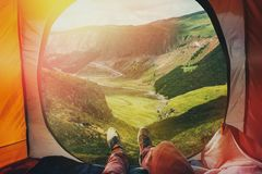 View from inside a tent on the mountains in Elbrus, Point Of View Shot. Travel Destination Hiking Adventure Concept. View from ine a tent on the mountains in Stock Images