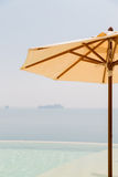 View from infinity edge pool with parasol to sea Royalty Free Stock Image