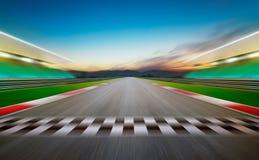 View of the infinity empty asphalt international race track. Night scene Stock Photos
