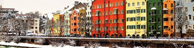 View of the Inn river in winter in Innsbruck, Austria during the early morning, trees and mountains at the background. Innsbruck, Austria. View of the Inn river stock photos