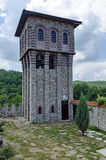 View of inner  part yard with  bell tower in restored Montenegrin or Giginski monastery. St. St. Cosmas and Damian, mountain  Kitka, Breznik, Pernik region Royalty Free Stock Image