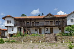 View of inner  part yard with old monastic house in restored Montenegrin or Giginski monastery. St. St. Cosmas and Damian, mountain  Kitka, Breznik, Pernik Stock Photography