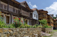View of inner  part yard with old and new monastic house in restored Montenegrin or Giginski monastery. St. St. Cosmas and Damian, mountain  Kitka, Breznik Stock Images