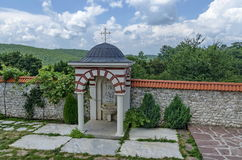 View of inner  part yard with  spring water fountain in restored Montenegrin or Giginski monastery. St. St. Cosmas and Damian, mountain  Kitka, Breznik, Pernik Royalty Free Stock Images