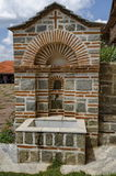 View of inner  part yard with  spring water fountain in restored Montenegrin or Giginski monastery. St. St. Cosmas and Damian, mountain  Kitka, Breznik, Pernik Royalty Free Stock Image