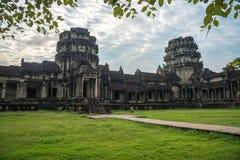 View from inside an Angkor Wat in Siem Reap, Cambodia. View from inside an Angkor Wat in cloudy day in Siem Reap, Cambodia royalty free stock photo