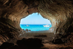 View from inside big cave to the beach Stock Images