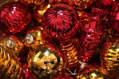View inside a box full of Christmas balls. View inside a box full of red and gold Christmas balls. Decorating the Christmas tree Stock Images