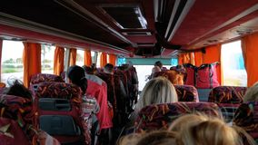 View inside the bus cabin with tourists traveling on an exotic road with palm trees. Sharm El Sheikh, Egypt, April 4, 2019: Travelling bus with tourists. View stock footage