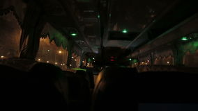 View from inside a bus at night