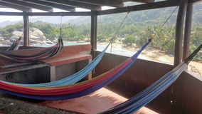View from inside Cabo San Juan. Hammocks in cabo san juan hut with beach and ocean in Tayrona National Park, North Colombia Stock Photo
