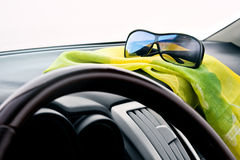 View from inside the car. With the sunglasses in the foreground Stock Photos