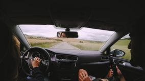 View from inside car on couple driving