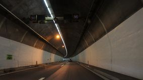 View from inside car and road in tunnel. Mountain pass stock images