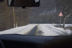 View from inside car on snow covered road Royalty Free Stock Photos