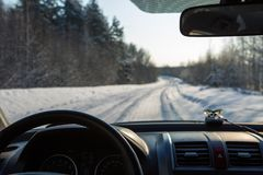 View from inside the car on the snow-covered road. In a forest Royalty Free Stock Photography