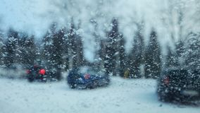View from inside car to snow flakes on windshield royalty free stock photo