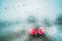 View From Inside The Car Through The Window Covered With Rain Drops royalty free stock image