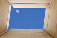 View from inside a cardboard box. Full-moon in the sky outside t. He box. Freedom concept royalty free stock image