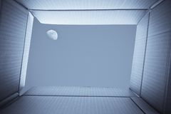View from inside a cardboard box. Full-moon in the sky outside t. He box. Freedom concept royalty free stock photography