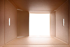 View from inside a cardboard box. White light outside Royalty Free Stock Images