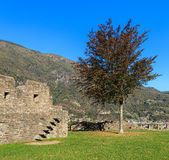 View inside the Castelgrande fortress in Bellinzona, Switzerland. Mountains in the background. The Castelgrande fortress is a UNESCO World Heritage Site and Royalty Free Stock Photography