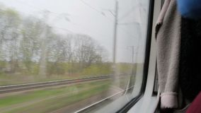 View inside of the fast train with passengers. Daylight, indoor. View from the window of moving train. Green nature, sunny day in the view stock video