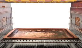 Inside The oven. A view from inside a hot operational household oven looking out the open door with an empty tanished baking tray inside - 3D render Royalty Free Stock Photography