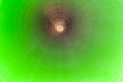 View inside of long plastic tube under ground. Royalty Free Stock Photo