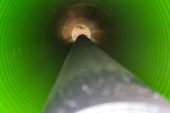 View inside of long plastic tube under ground. Royalty Free Stock Images