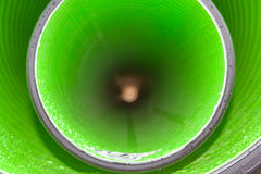 View inside of long plastic tube under ground. Stock Images