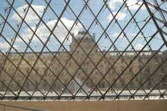 View from inside Louvre in Paris, France. View from inside the glass triangle at the Louvre Museum in Paris, France Royalty Free Stock Images