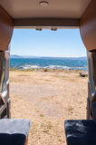 View from inside for a motorhome. View of the beach from the back of a motorhome Royalty Free Stock Images