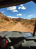 View from the inside of the off road vehicle White Rim Road Utah trails straight ahead Stock Photos