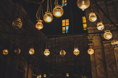 View inside old mosque at cairo, egypt. Cairo, egypt, february 25,2017: view of lamps inside old mosque at cairo, egypt Royalty Free Stock Photography