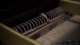 View of the inside of the piano. Day stock footage