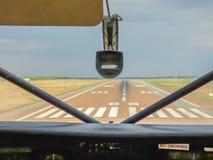 View Inside pilot cabin to aerodrome. View Inside pilot cabin on old airplane to the aerodrome runway landing, Botswana stock images
