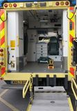 A view inside the rear compartment of an NHS ambulance at rest. Looking inside the back of an NHS ambulance showing equipment used Stock Photo