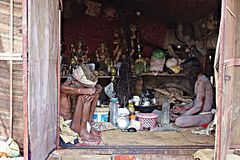 Naga Sadhu Hindu Ascetic in Meditation. A view inside the room of hindu mendicant monks doing tapasya a form of asceticism and renunciation by remaining in Stock Image
