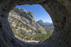View from inside a small cave.Crimea. Royalty Free Stock Photo