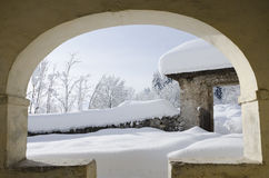 View from inside of a small church. A view from a small church at the snowy landscape Stock Photography