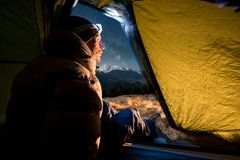 View from inside a tent on the male hiker have a rest in his camping at night Royalty Free Stock Image