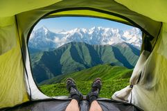 View from inside a tent on the snow-capped mountains in Georgia Royalty Free Stock Images