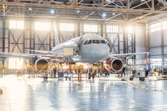 Free View Inside The Aviation Hangar, The Airplane Mechanic Working Around The Service Royalty Free Stock Images - 152748039